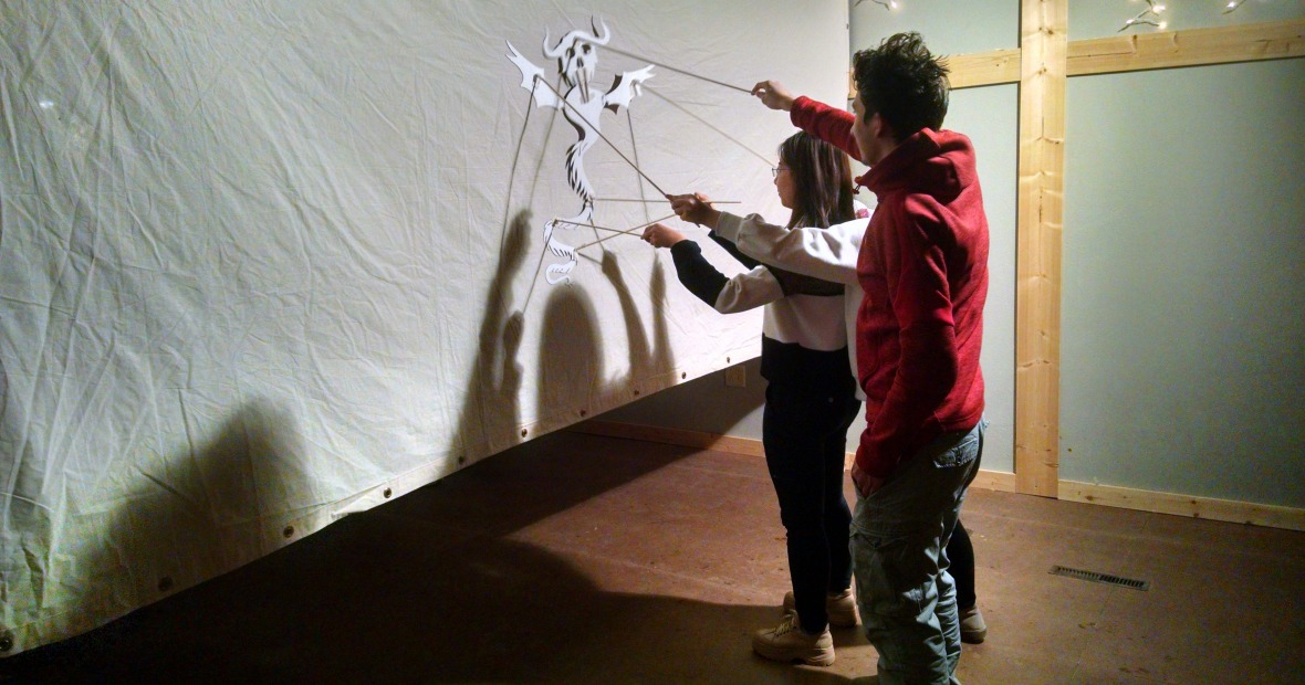 Two students using shadow puppet