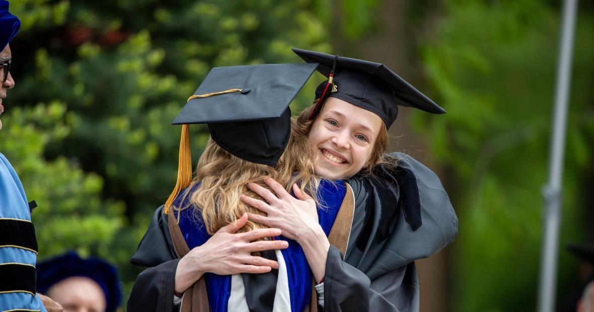 Siri Bruhn receives congratulatory hug