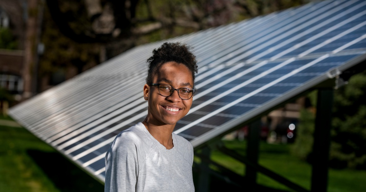 Avery Barnett near the College's solar panels on the east side of campus.