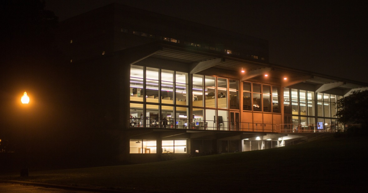 Burling Library at night, windows lit