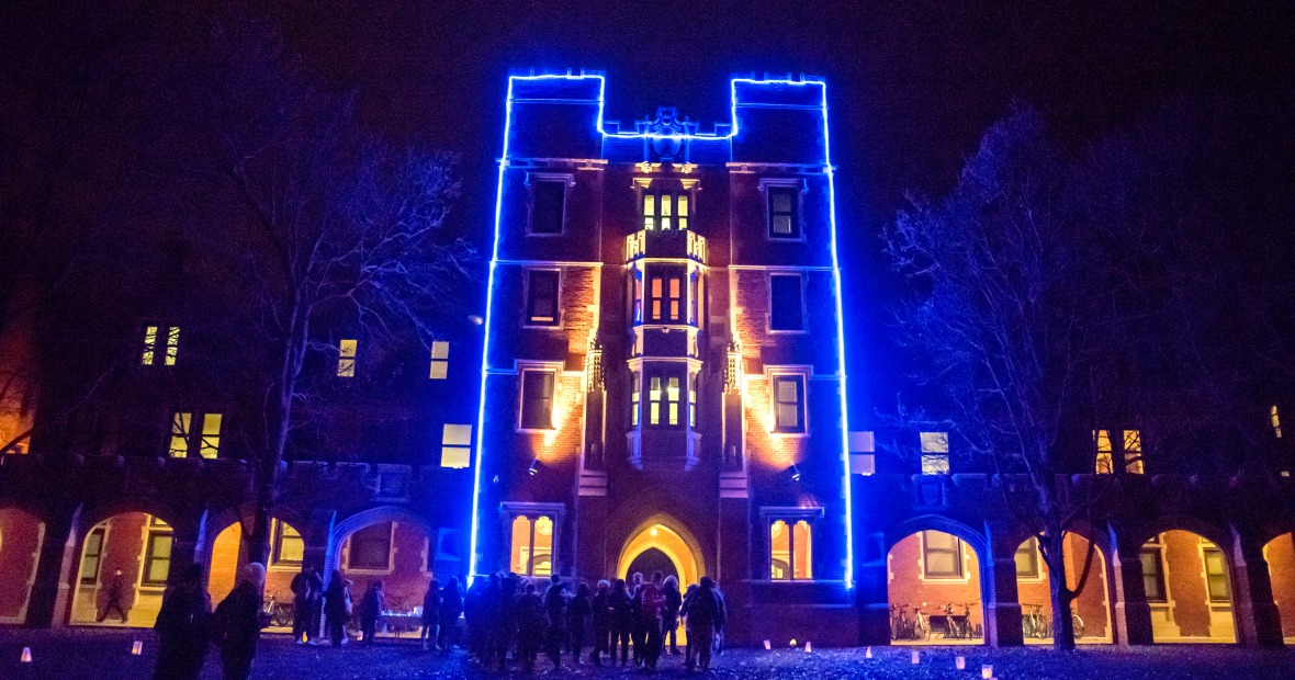 Gates Tower lit up in blue Christmas lights.