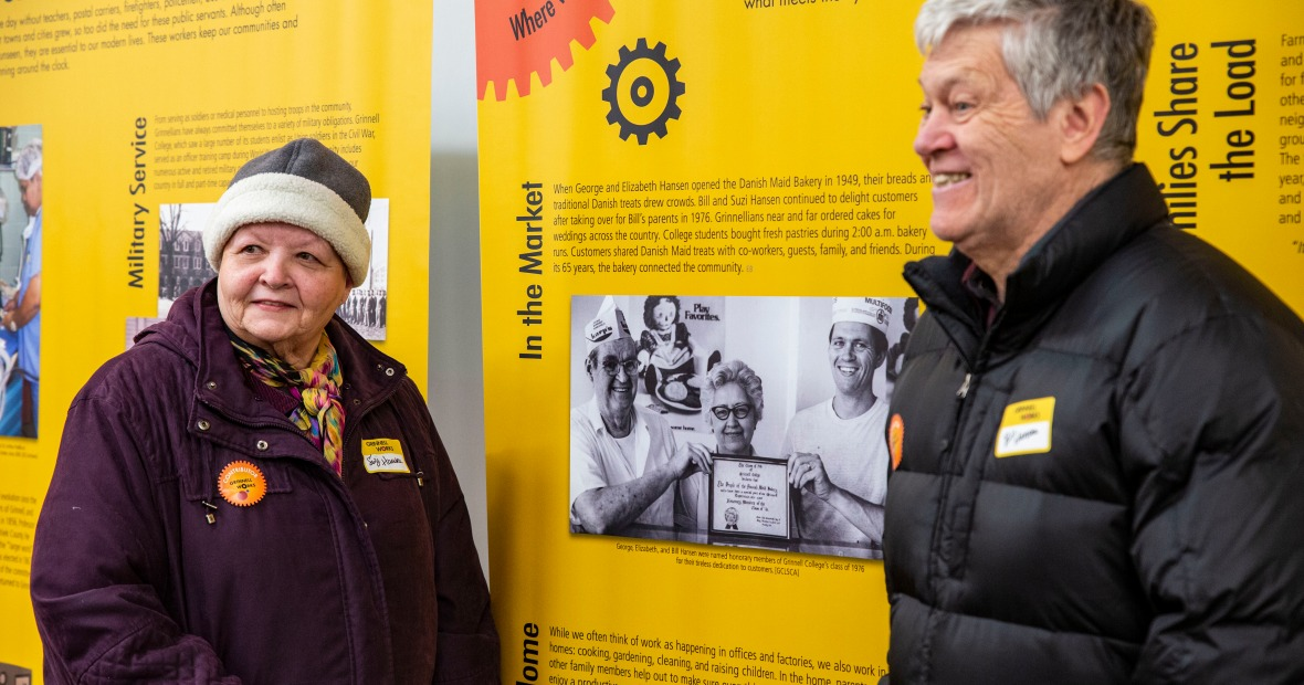 Bill and Suzie Hansen standing by a photo of Hansen's Bakery in the exhibit