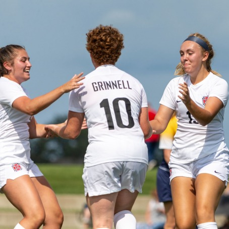 women's soccer players celebrate