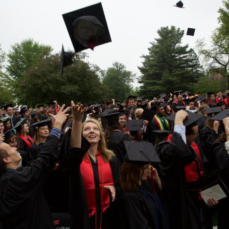 graduates throw caps at Commencement
