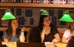Students at table with green-hooded lights