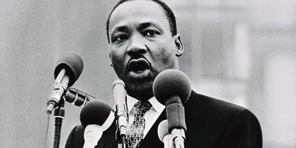 Martin Luther King, Jr. speaking behind several microphones