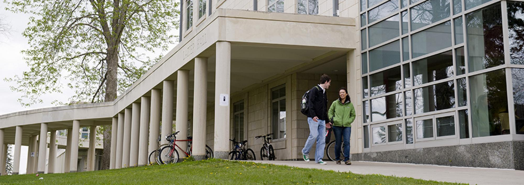 Students walk through East Campus loggia