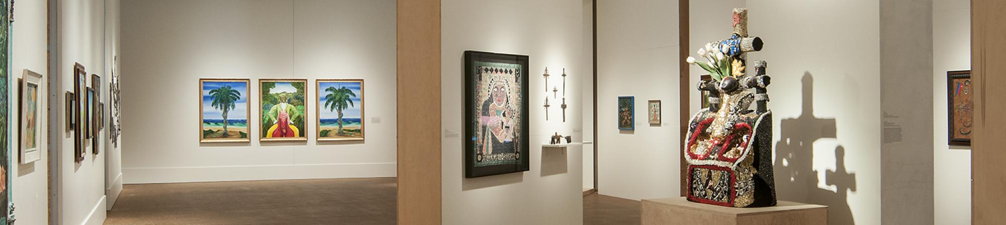 Works from En Voyage: Hybridity and Vodou in Haitian Art on display in Grinnell College Faulconer Gallery