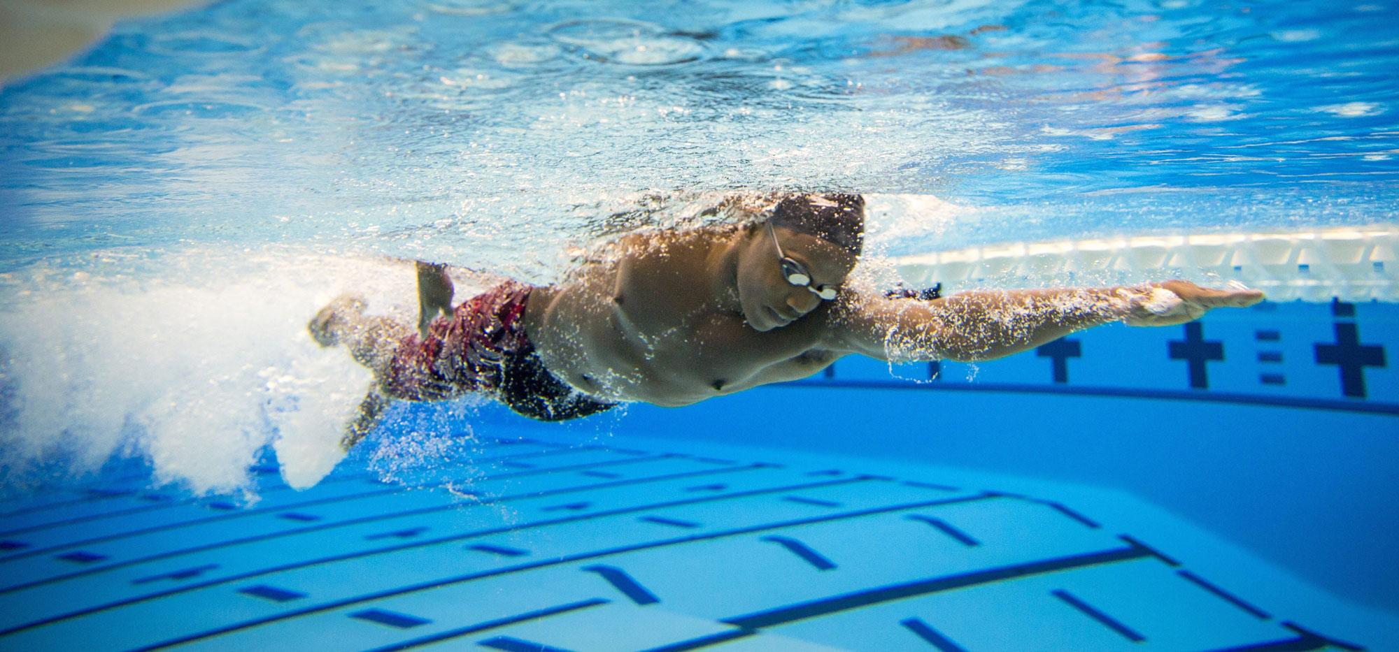 Joshua Tibatemwa swims laps as part of his training for the 50-meter freestyle.