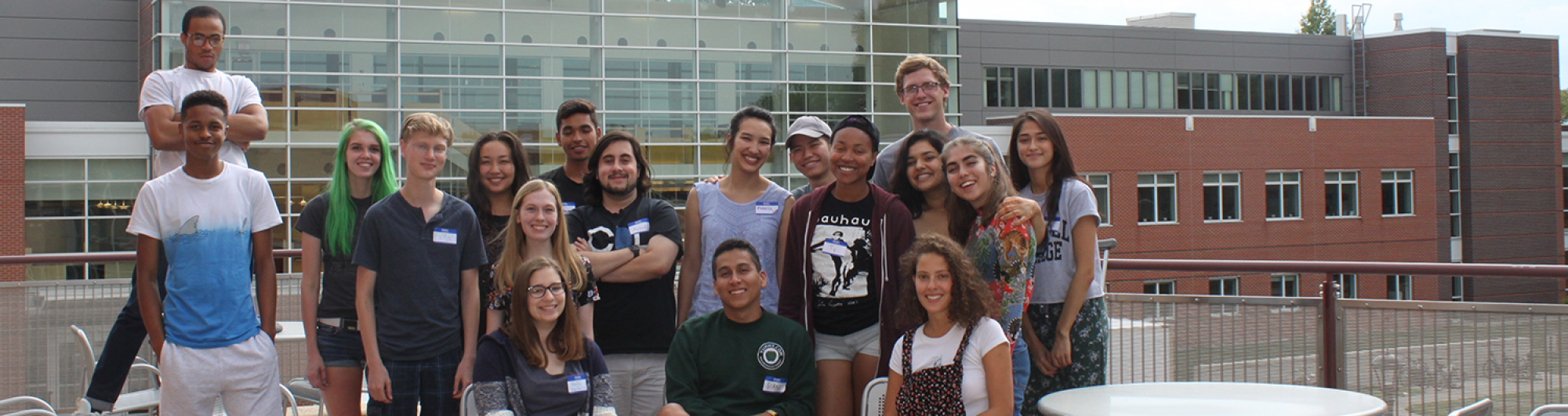 Students stand as a group for a posed photo.
