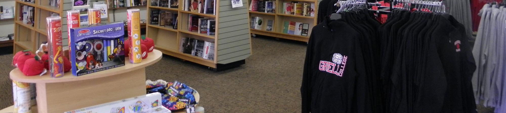 Interior of new Pioneer Bookshop, showing wide variety of books, games, and Grinnell College gear.