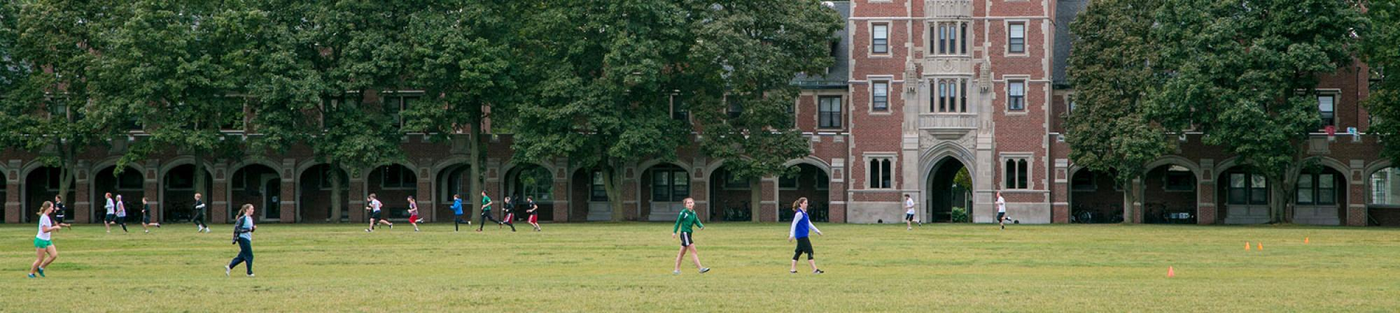 Students relax on Mac field
