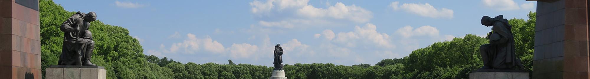 Statues of kneeling Soviet soldiers at the Treptower Park memorial in Berlin