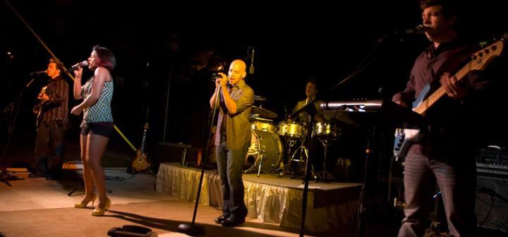 Maggi Speaks on stage at night