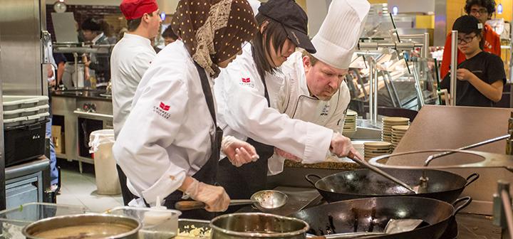Scott Turley supervises meal preparation