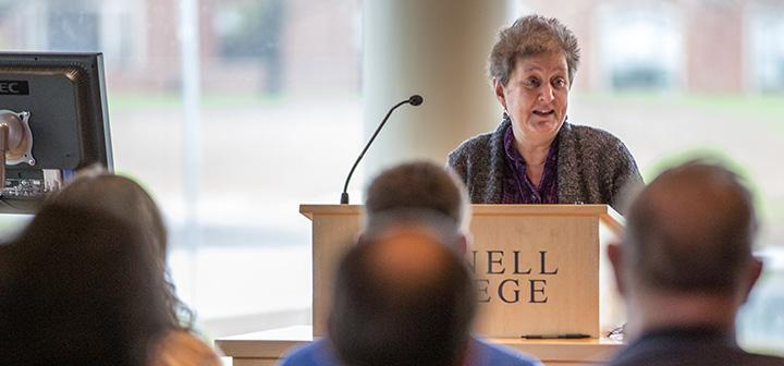 Writer Katha Pollitt addresses a gathering in the Rosenfield Center.
