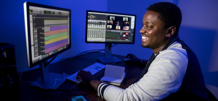 Austin Morris '15 at computers, working on the virtual choir