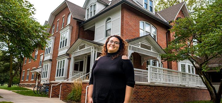 Lizeth Gutierrez '12 stands in front of Mears Cottage