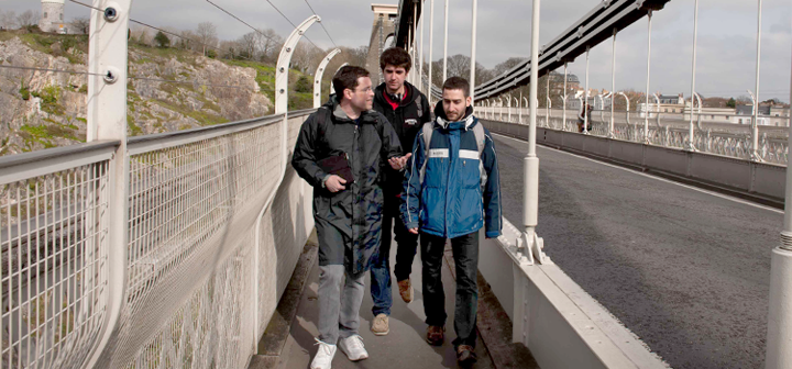 Students walking across a bridge