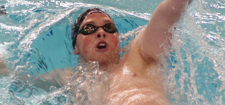 Michael Brus '14 doing the backstroke