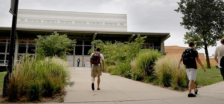 Students walk toward Burling Library