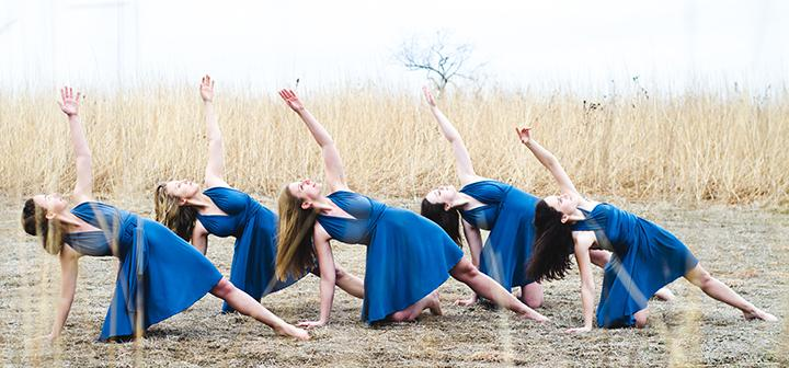 5 dancers performing in a prairie