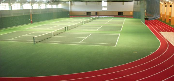 interior of fieldhouse showing tennis courts
