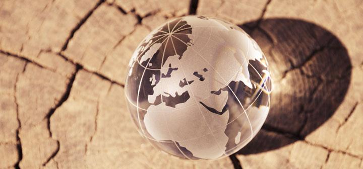 Poster image: etched crystal globe on dried, cracked mud