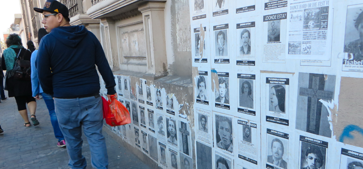 "posters of ""Los desaparecidos"" (the disappeared ones) used to reclaim public spaces"