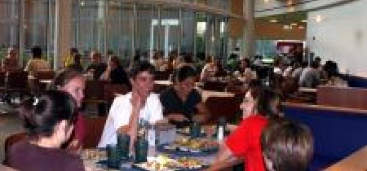 With dinner finished, students chat over their empty dining hall trays
