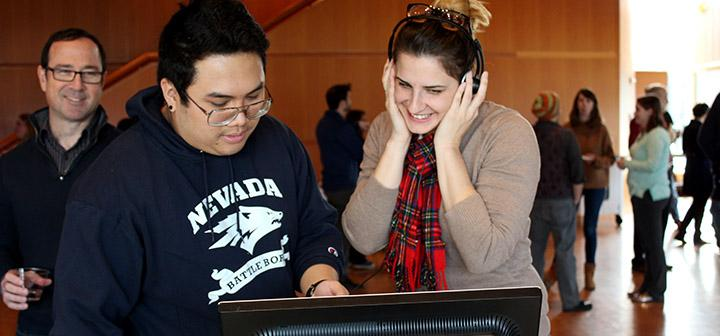 Jarren Santos '17 demonstrates YouTube channel Tipping Point Math to Keira Wilson while Prof. Marc Chamberland looks on