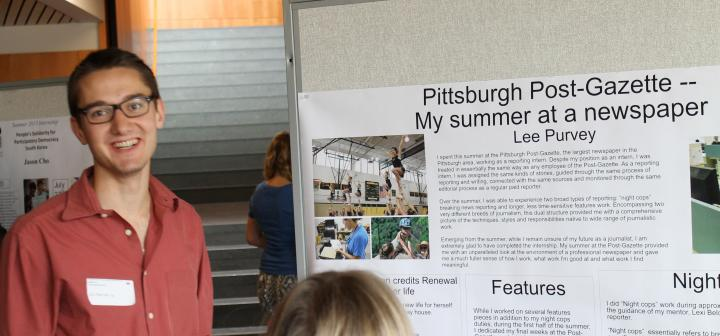 Lee Purvey '14 in poster session sharing details about his internship