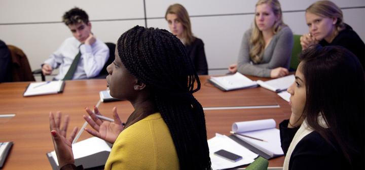 Woman talking while rest of group listens