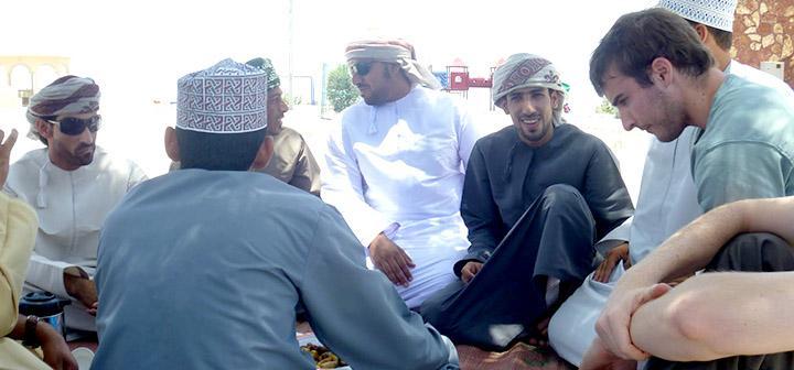 Men sitting in circle