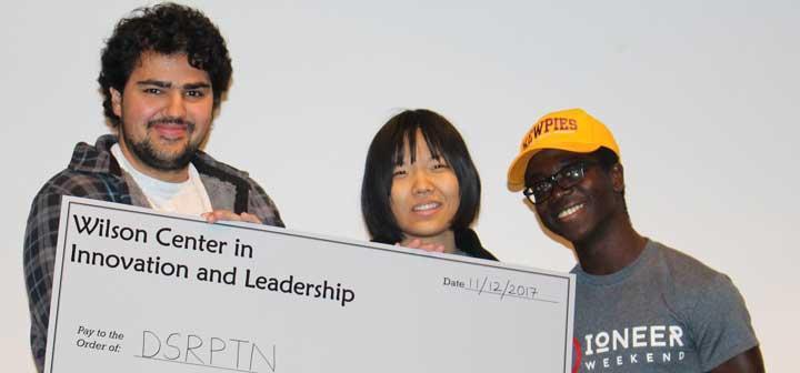Yash Gupta, Nicole Nie, and Papa Kojo Ampim-Darko with their award