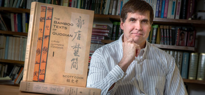 Scott Cook with volumes I and II of his book, The Bamboo Texts of Guodian
