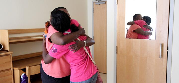 Two women hug