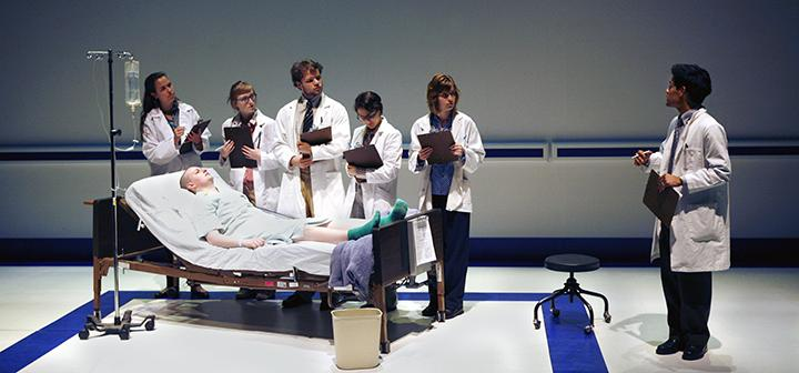 Wit scene - doctors at patient bedside