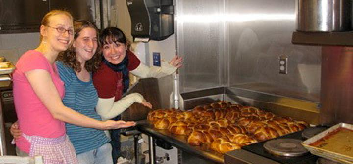 Students posing with challah