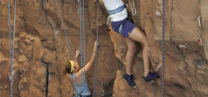 2 people climbing wall