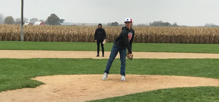 students play baseball on Iowa's Field of Dreams