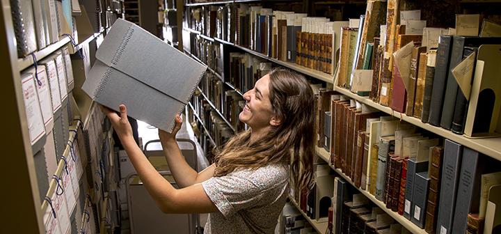 Diane Lenertz '15 reshelving archive materials