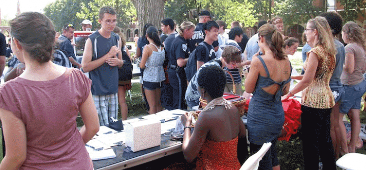 Students approach table during Grinnell Fest