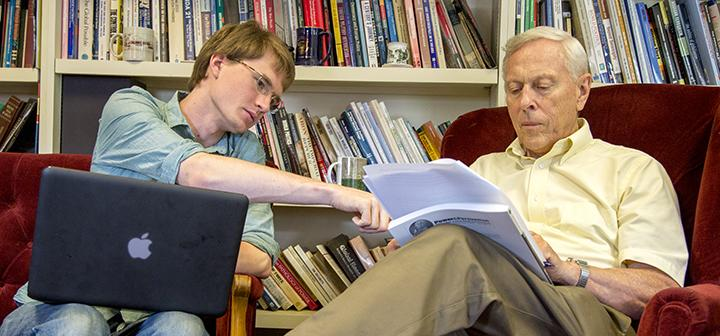 Joseph Wlos '15 and Wayne Moyer, professor of political science, discuss the principle of habeas corpus.