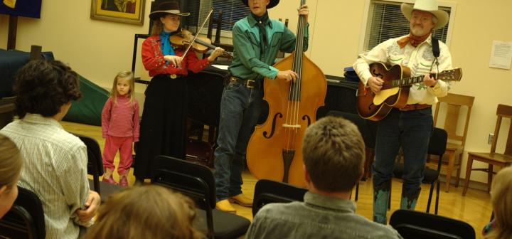 The Double D Wranglers—(from left) Charity Gudgel , Chris Gudgel, and Paul Siebert—demonstrate cowboy yodeling at the yodeling workshop on Nov. 13, 2009.