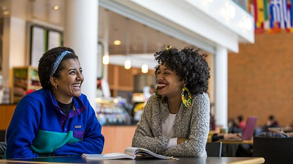 Two students talk in the Grill in the JRC