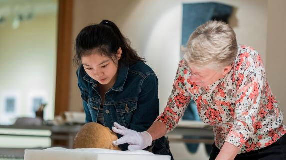 Student and professor examine a skull