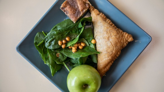 Marnie's lunch--a spinach salad, a turnover, a green apple, and a dessert bar