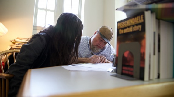 A student receives help from the Writing Lab