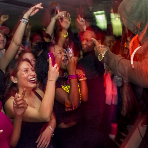 Students dance at a concert in Gardner Lounge